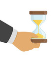 hourglasses in hand vector image vector image