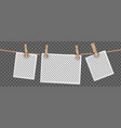 retro photo frames hanging on rope isolated on vector image