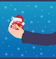 christmas ball in hand with snow vector image