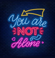 neon lettering you re not alone motivational vector image