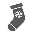 christmas stocking glyph icon christmas vector image vector image