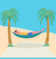 man lying in a hammock attached to palm trees vector image