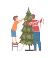 father and son decorating christmas tree vector image vector image