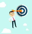 business man hold arrow and shoot to the goal vector image
