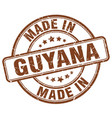 made in guyana brown grunge round stamp vector image vector image