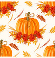 seamless pattern with leaves and pumpkins vector image