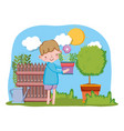 little boy lifting houseplant with fence and tree vector image vector image