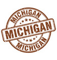 michigan brown grunge round vintage rubber stamp vector image vector image