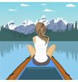 woman traveler floating on boat on mountain lake vector image