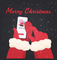 santa hands using mobile app man with gift present vector image