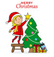 little girl placing the star on the christmas tree vector image vector image