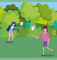 young couple with tennis rackets in park vector image