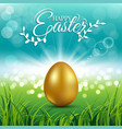 gold egg on fresh spring grass for easter day vector image