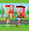two boys raking leaves in the yard vector image vector image