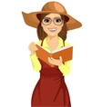 Woman with garden hat reading gardening journal vector image