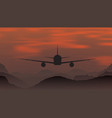 an airplane flying at sunset in mountains vector image vector image