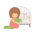 cute little girl feeding rabbits in cage with vector image vector image