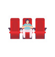 young man sitting in cinema theatre and watching vector image vector image