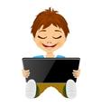 little boy having fun playing using digital tablet vector image vector image