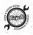 bicycle wheel and wrench round emblem vector image vector image