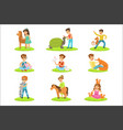 children petting the small animals in petting zoo vector image