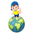 Cute boy standing on the world