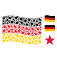 waving germany flag pattern of confetti star items vector image