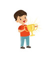 cute little boy holding winner cup kids physical vector image vector image