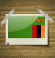 Flags Zambiaat frame on a brick background vector image