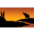 Meerkat and elephant in riverbank vector image vector image