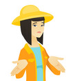young asian confused farmer shrugging shoulders vector image vector image