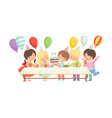cute boys and girls in party hats sitting at vector image vector image