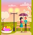 couple under umbrella in park near streetlight vector image
