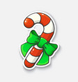 cartoon sticker with candy cane and ribbon vector image