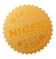 golden niger medal stamp vector image vector image