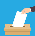 hand putting voting paper in ballot box vector image vector image