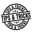 tips tricks round grunge black stamp vector image vector image