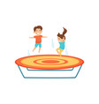 little boy and girl jumping on trampoline kids vector image vector image