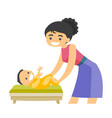 young caucasian white mother taking care of baby vector image