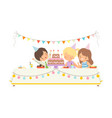 cute children sitting at festive table adorable vector image vector image