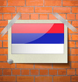 Flags Republika Srpska scotch taped to a red brick vector image