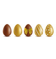 Set chocolate eggs - golden and brown