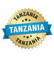 tanzania round golden badge with blue ribbon vector image vector image