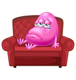A crying monster sitting on a red sofa vector image vector image