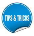 tips tricks round blue sticker isolated on white vector image vector image