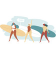 three surfer girls walking with boards vector image