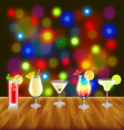 Cocktails on wooden table and bar lights vector image vector image