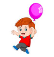 a kid holding balloons vector image vector image