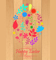 easter egg made from flowers on wooden background vector image vector image