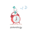 somnology stands next to the alarm vector image vector image